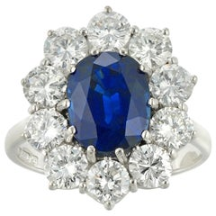 Oval Sapphire and Diamond Cluster Ring