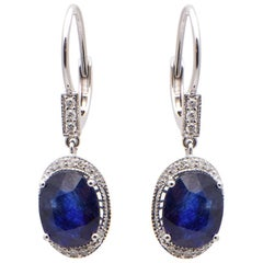 Oval Sapphire and Diamond Drop Earrings in 18 Carat White Gold
