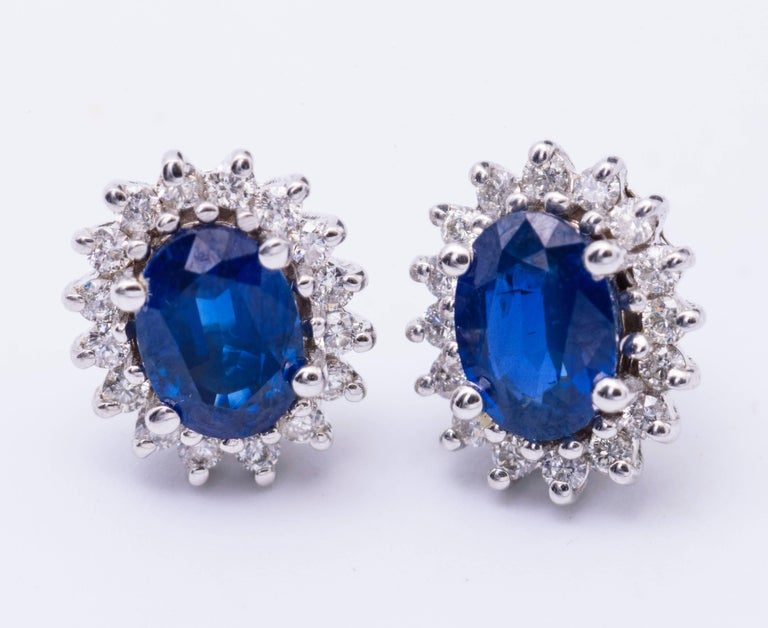14K White gold 7 x 5 mm sapphire 1.88 Cts. Diamonds 0.39 Earrings measures 11.25 x 9.5 mm