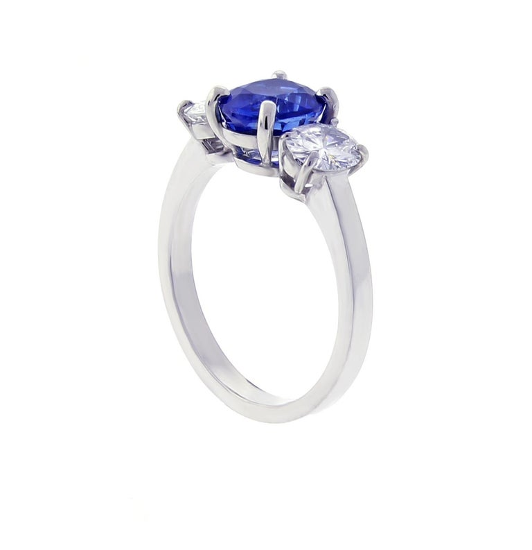From the master ring makers of Pampillonia jewelers an oval sapphire and diamond handmade ring. ♦ Designer: Pampillonia ♦ Metal: Platinum   ♦ Sapphire=1.95 Ceylon, presumed heated ♦ 2 oval diamonds=.77 E-F VS ♦ Circa 2020 ♦ Size 6, Resizable ♦