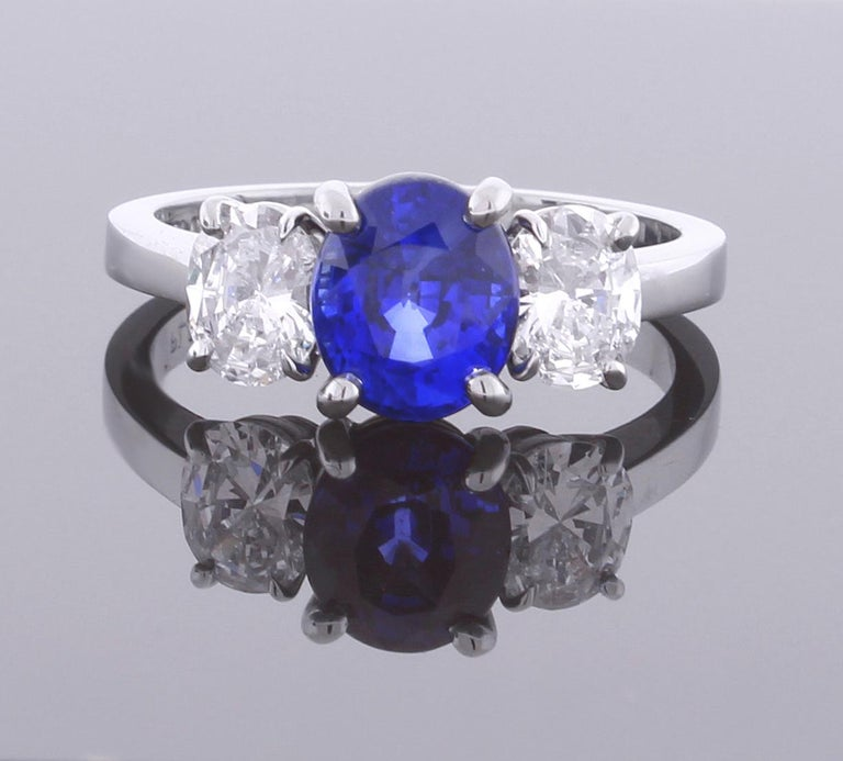 Oval Cut Oval Sapphire and Diamond Three-Stone Ring For Sale