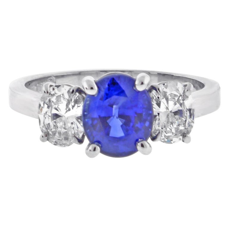 Oval Sapphire and Diamond Three-Stone Ring For Sale