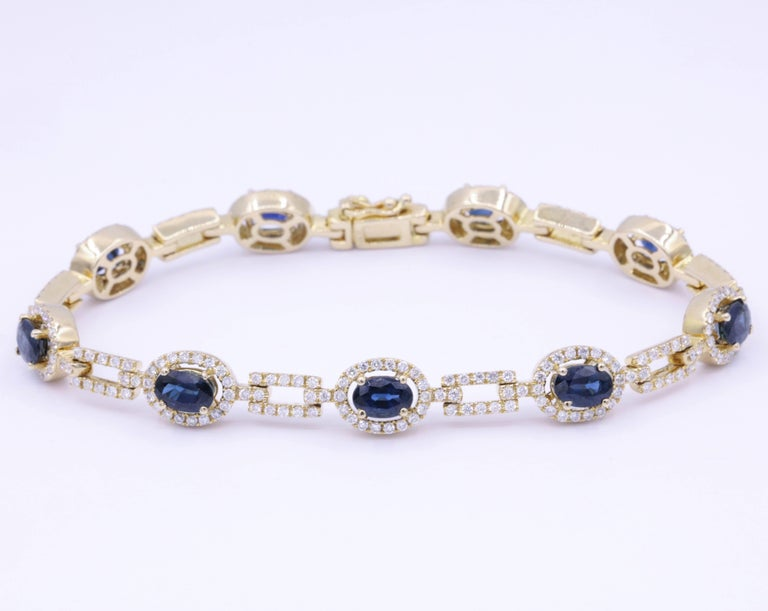 9 Sapphire each one  6x4 mm Total Weight 6.64 Carats Diamonds: 1.99 Carats 14K Yellow Gold