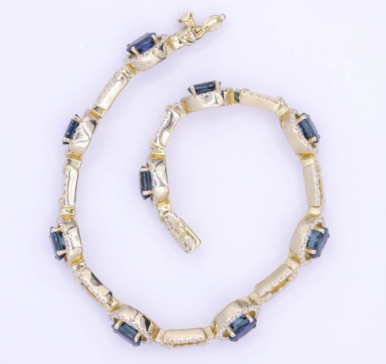Oval Cut Oval Sapphire and Diamond Yellow Gold Bracelet 8.63 Carat For Sale