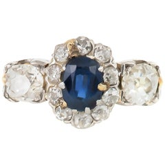 Oval Sapphire Center Stone with Different Diamonds Cut Around