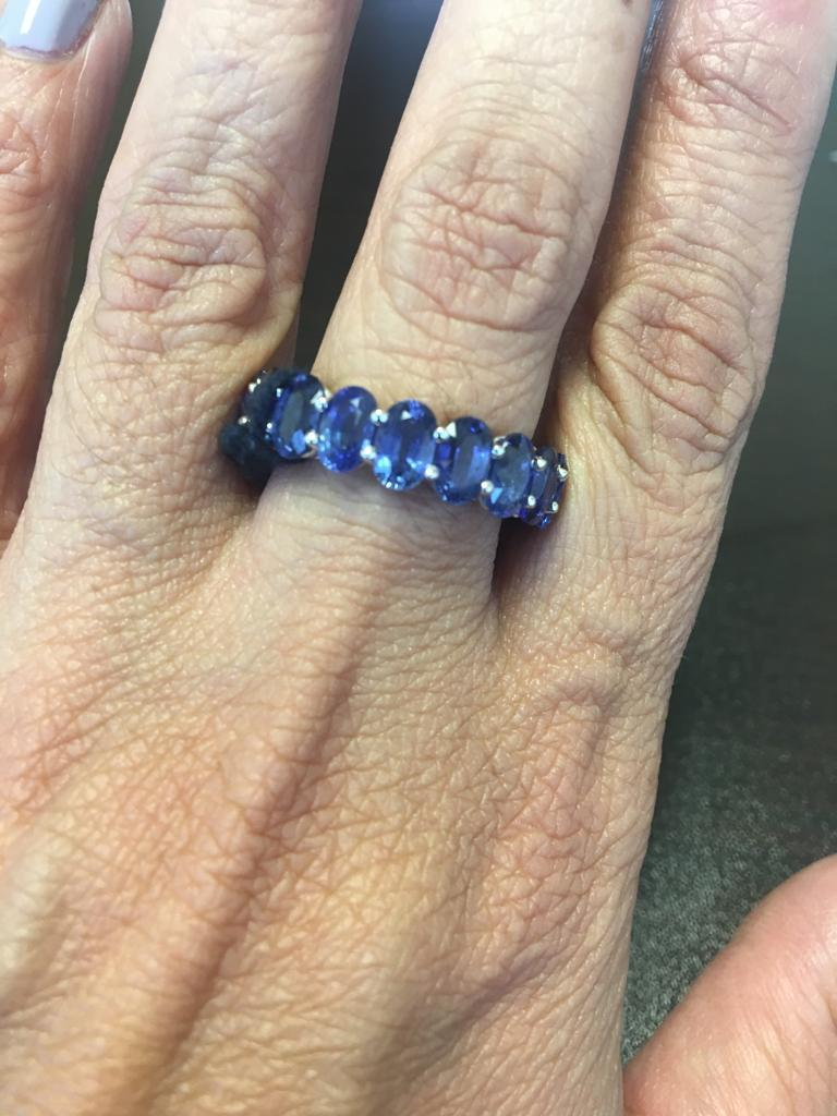This stunning eternity band is made of 18 perfectly matched oval stones. The superb quality of this Ceylon sapphires make this ring a unique piece. The ring is set in 18K white gold, and the total weight of the ring is 12.45 carats. The size of the