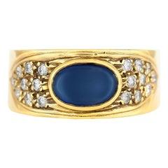 Oval Sapphire on 18 Karat Yellow Gold Setting with Diamonds