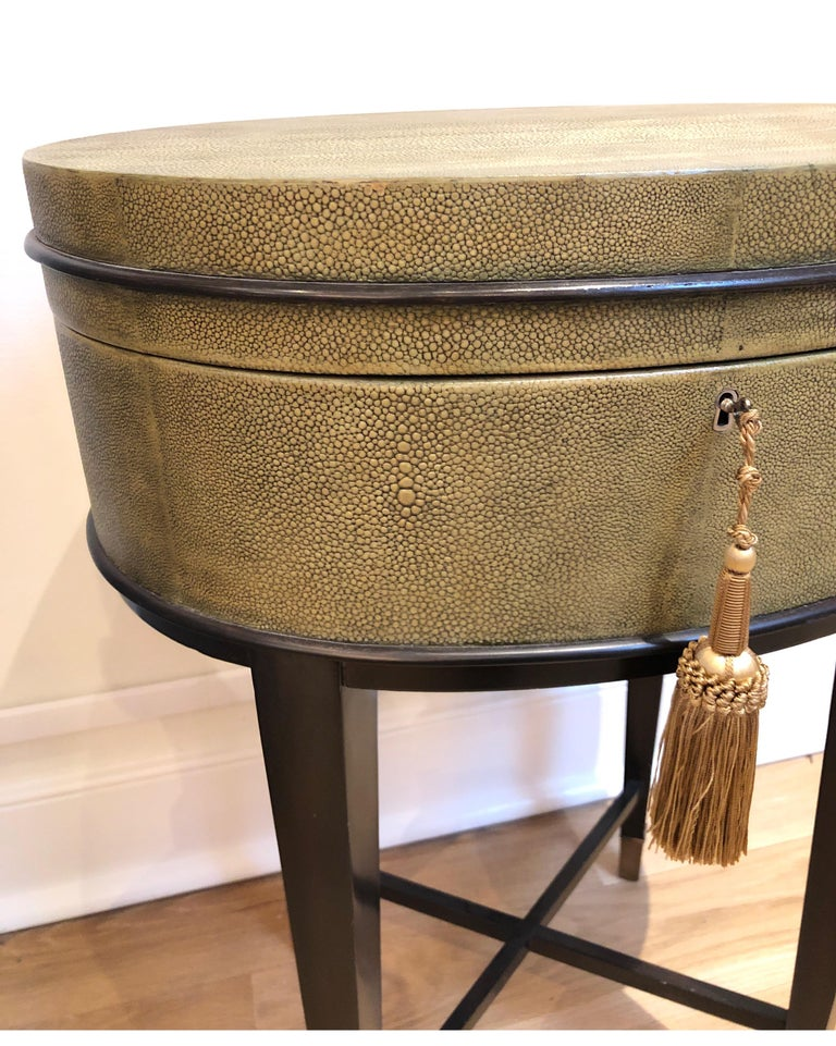 Oval Shaped Faux Shagreen Side Table. Top lifts for storage. Very unique table in great condition. Brass lock missing key. We have a dummy provided with tassel.   Attributed/In the Style of R&Y Augousti