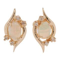 Oval Shape Opal and Diamond Stud Earrings of 14 Karat Yellow Gold