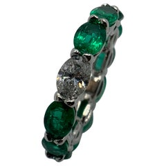 Oval Shaped Emerald and Diamond Horizontally East West Eternity Band Ring