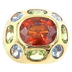 Oval Shaped Spessatite Blue Topaz Peridot Gold Cocktail Ring