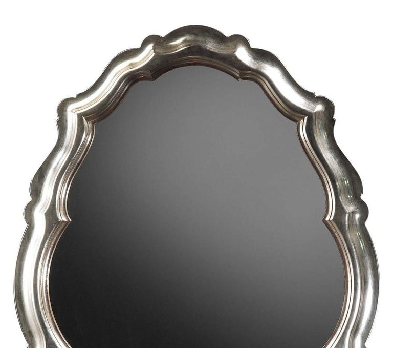 Oval silver wall mirror by Spini Firenze.