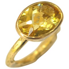Oval Six Carat Yellow Zircon 18 Karat Gold Ring Handmade by Disa Allsopp