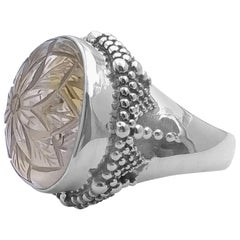 Stephen Dweck Carved Oval Smokey Quartz in a gold plated Ring