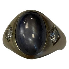 Oval Star Sapphire and Two Round Diamond White Set in White Gold Ring