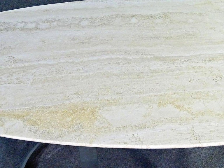 Sleek polished chrome base table with oval stone top. (Please confirm item location - NY or NJ - with dealer).