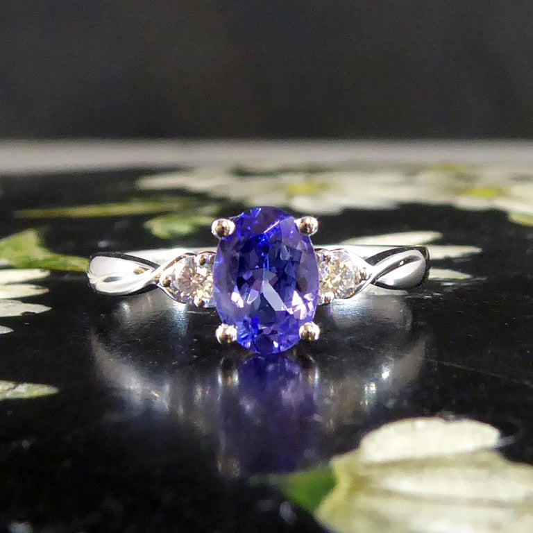 Modern Oval Tanzanite and Diamond Three Stone Ring in Platinum For Sale