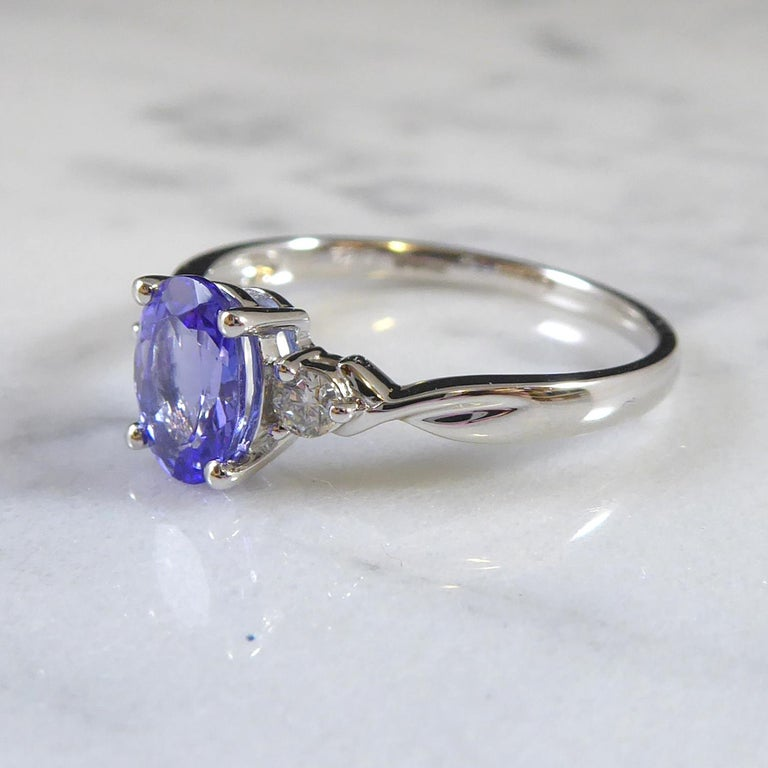 Oval Cut Oval Tanzanite and Diamond Three Stone Ring in Platinum For Sale