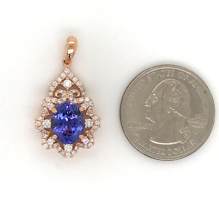 18K Rose gold pendant featuring one oval cut tanzanite, 2.82 carats, with round brilliants weighing 0.67 carats. Comes with a 18k rose gold chain, 16 inches.   Color G Clarity VS-SI