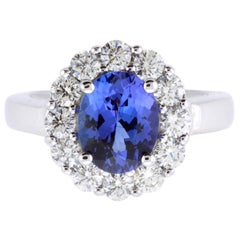 Oval Tanzanite Flower Halo Engagement Ring