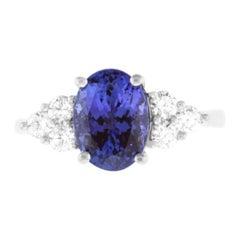 Oval Tanzanite Round Diamond Side Stone Cocktail Engagement Ring 14K White Gold