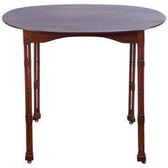 Oval Topped Regency Mahogany Side Table on Casters