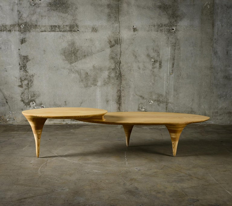 Michael Wilson two-level coffee table in oval form.