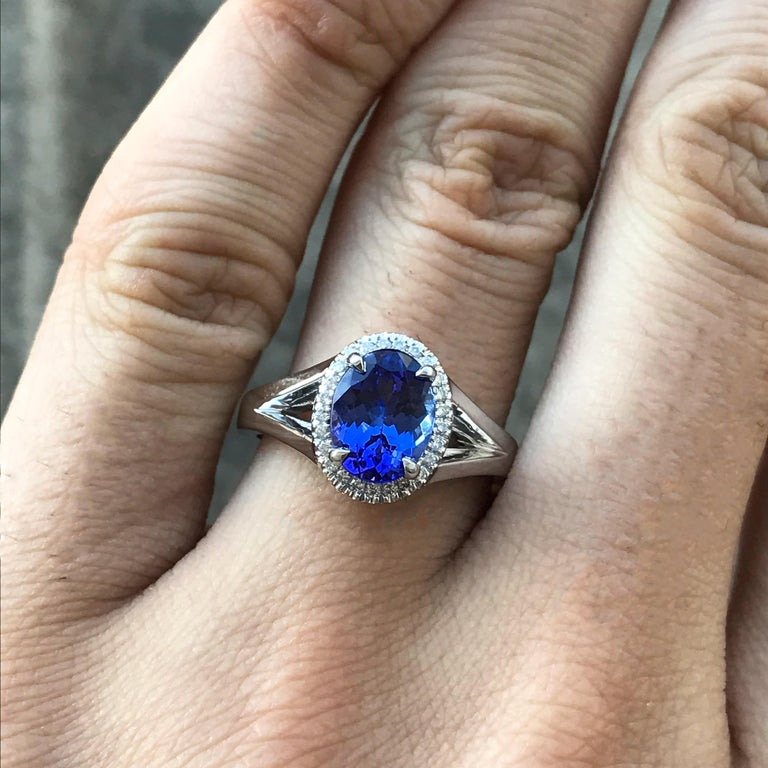 Ring will be made to order for your finger size, please allow 3-6 weeks.  Stunning 2.00 Carat  Oval Tanzanite set in a hand designed 18k White Gold. The stone is enhanced three round diamonds on each side.  AS015 - 2000071  Center Stone Details: