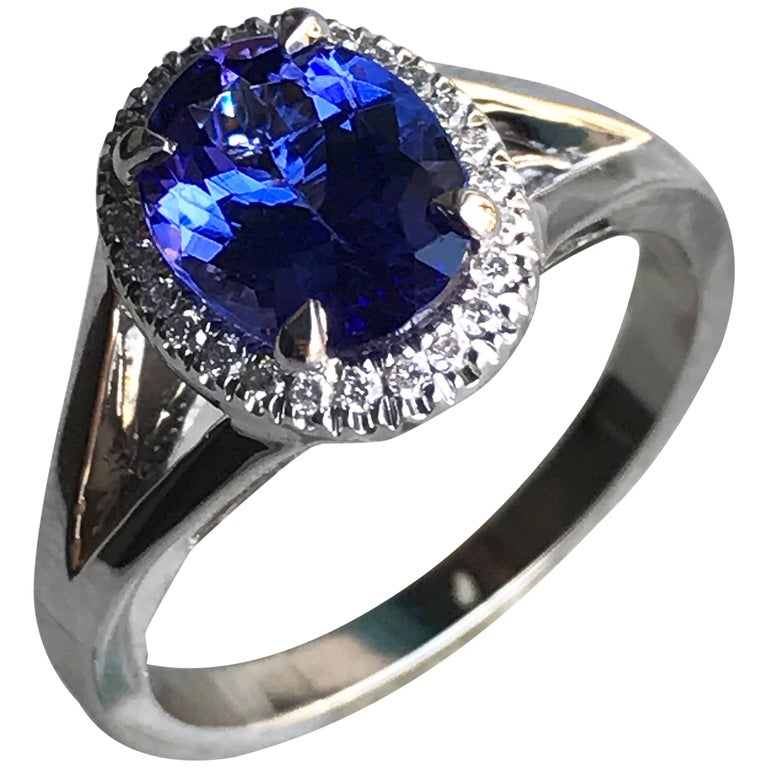 Oval Violet Tanzanite with Diamond Engagement Halo Ring, 18 Karat White Gold For Sale