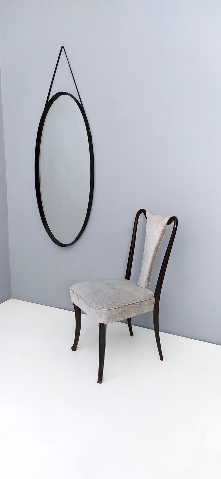 Mid-Century Modern Oval Wall Mirror with Ebonized Wood Frame and a Leather Hook, Italy For Sale