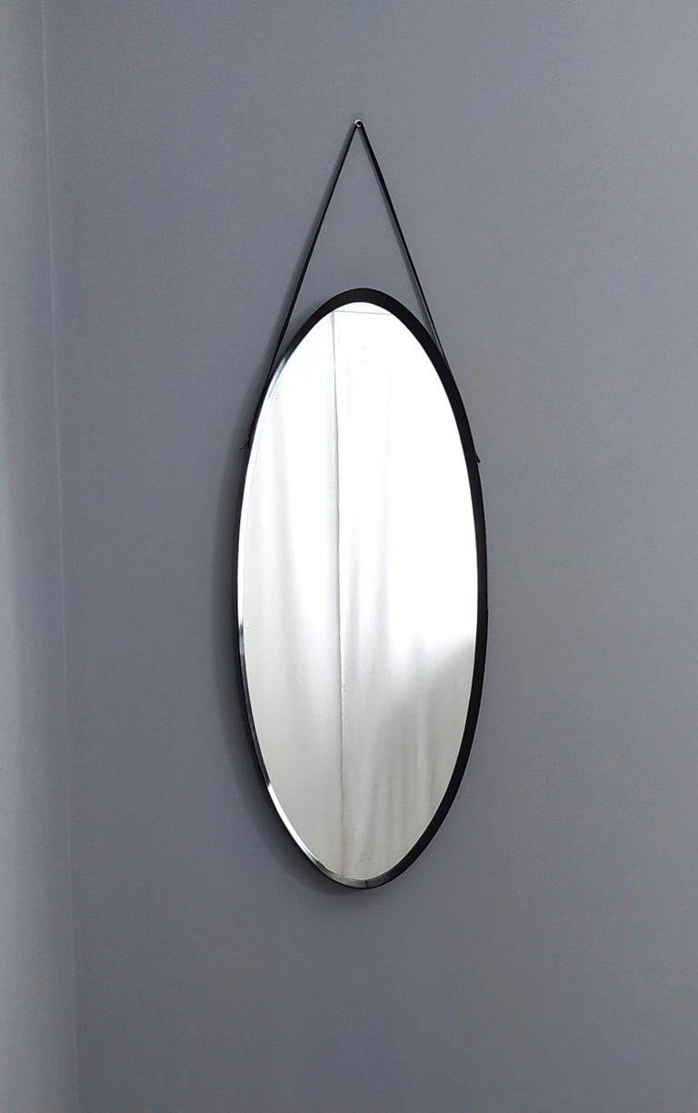 Italian Oval Wall Mirror with Ebonized Wood Frame and a Leather Hook, Italy For Sale