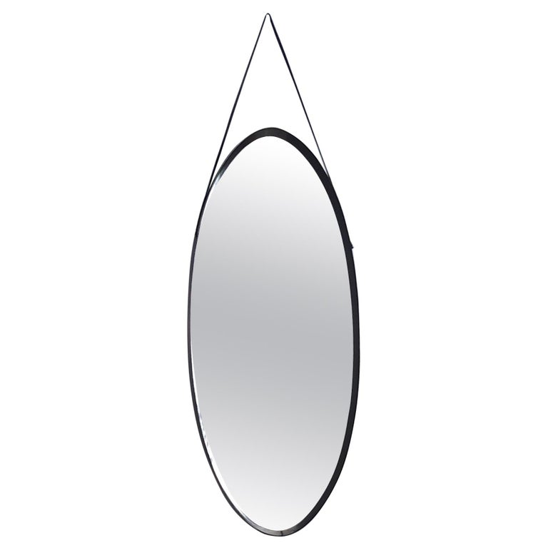 Oval Wall Mirror with Ebonized Wood Frame and a Leather Hook, Italy For Sale