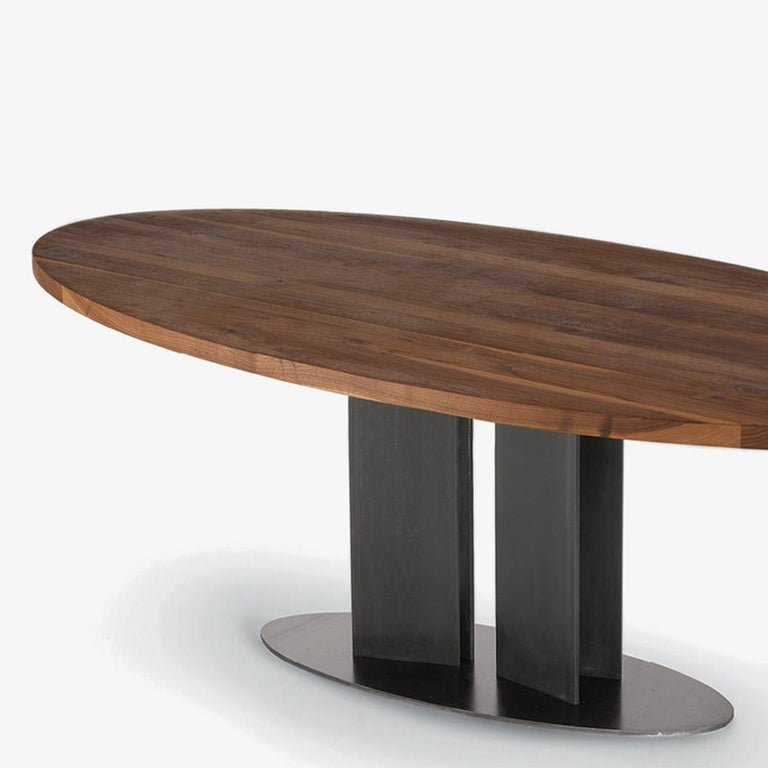 Dining table oval walnut with solid walnut top and with iron base in lacquered matt finish. Available in: L 200 x D 100 x H 75cm, price: 8400,00€ L 220 x D 100 x H 75cm, price: 8900,00€ L 240 x D 100 x H 75cm, price: 9400,00€ L 260 x D 100 x H