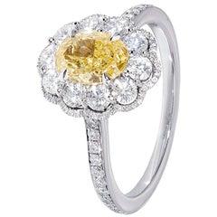 0.73 Yellow Diamond and platinum Daisy Cluster Ring