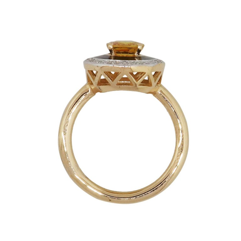 Material: 18k rose gold Diamond details: Approximately 0.18tw of round brilliant diamonds. Diamonds are G/H in color and VS in clarity Gemstone details: Oval shape yellow sapphire approximately 1.46ct Measurements: 1.05″ x 0.59″ x 0.84″ Ring Size: