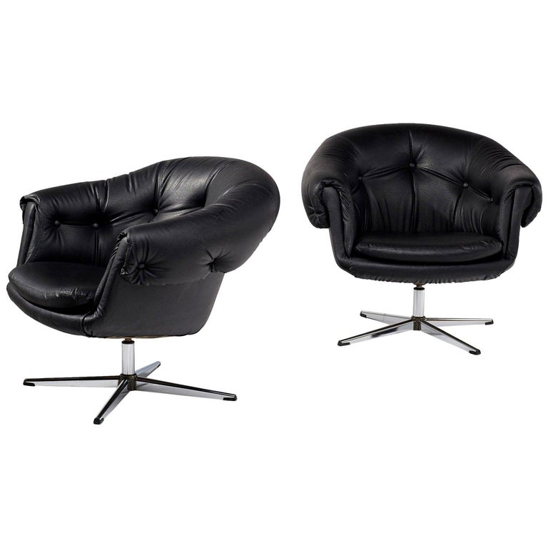 Iconic retro pod chairs in black vinyl, four-star base... similar to Swedish producer Overman. Use them as armchairs in the living room or as your desk chair. Unique button tufting give these chairs a touch of glamour.   Vinyl and leather are in