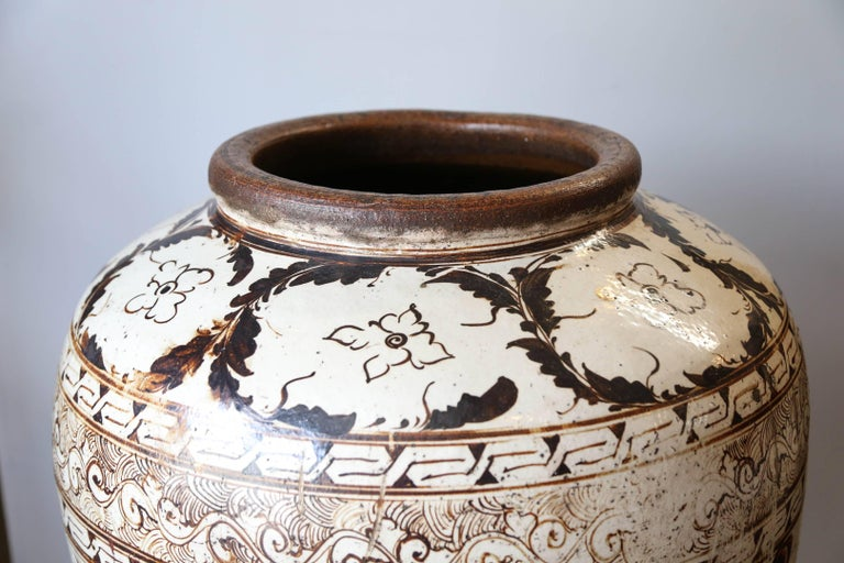 Beautiful very huge Cizhou ware brown painted ceramic jar with leaves and flowers decor. A wave band below the neck. Good condition. A very comparable but slightly smaller jar in the Metropolitan Museum collection under the accession number