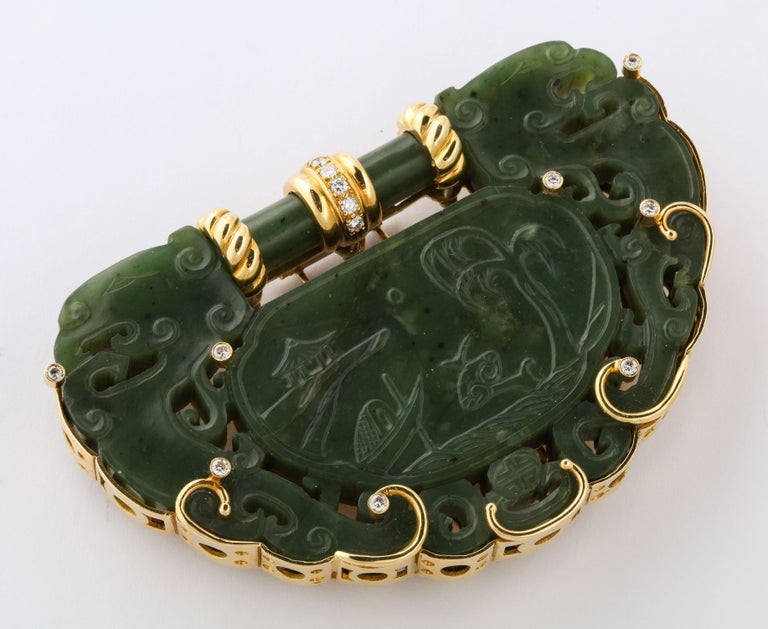 Hand made 18kt kt Yellow Gold Oversize Clip set around a Nephrite Jade Pierced and Decorated Chinese Carving which depicts a water scene with associated cloud elements. Piece Late 18th/19thCentury.  Mounting - custom made Ca 1940/60.  Set with 2