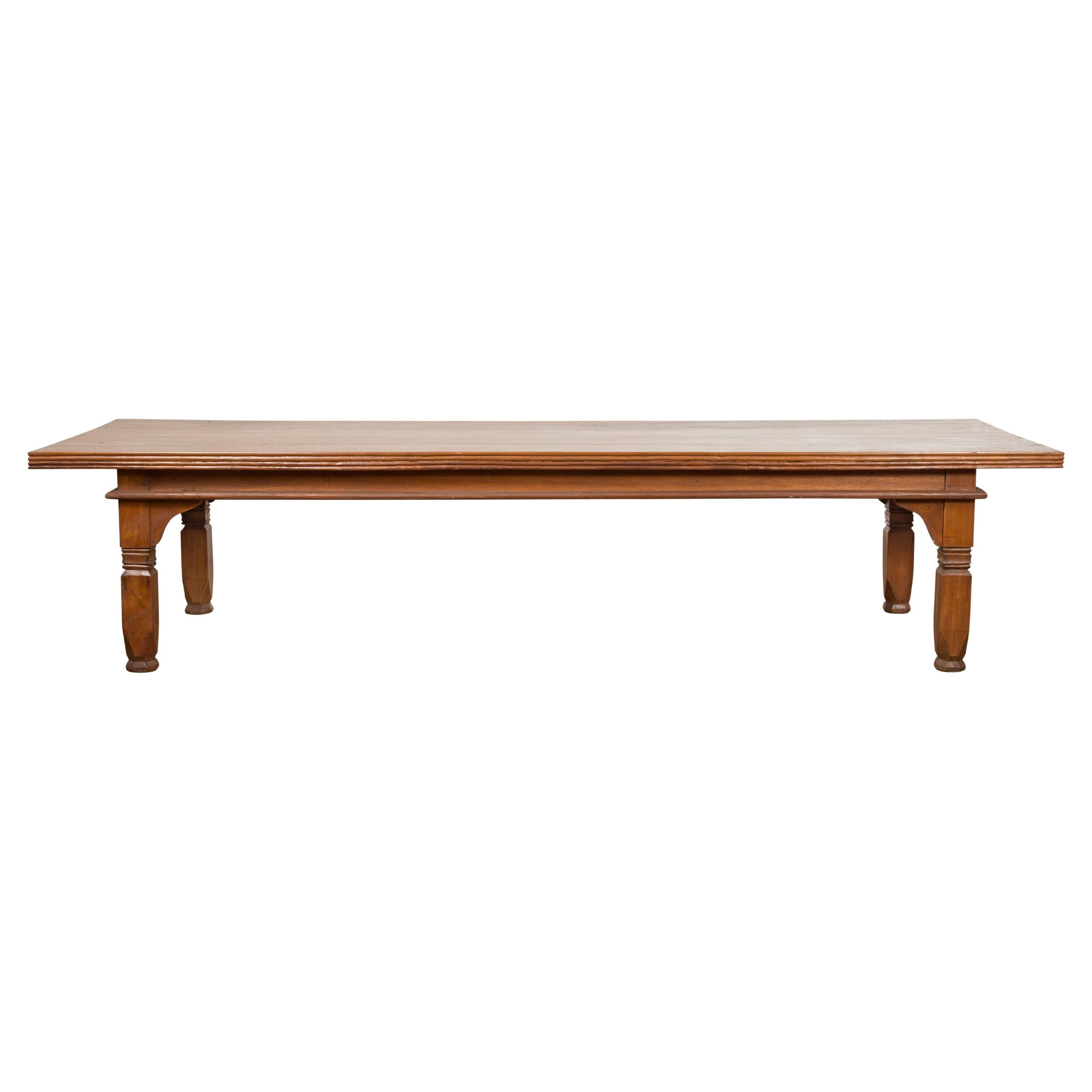 Oversized 19th Century Indonesian Coffee Table with Reeded Edge and Carved Legs