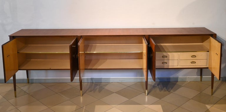 Oversized 6 door sideboard by Paolo Buffa Italy 1950 mahogany Paolo Buffa was an Italian architect and designer, best known for his midcentury furniture. Very rare and elegant 6 door mahogany sideboard, legs are made with brass sabots and a fitted