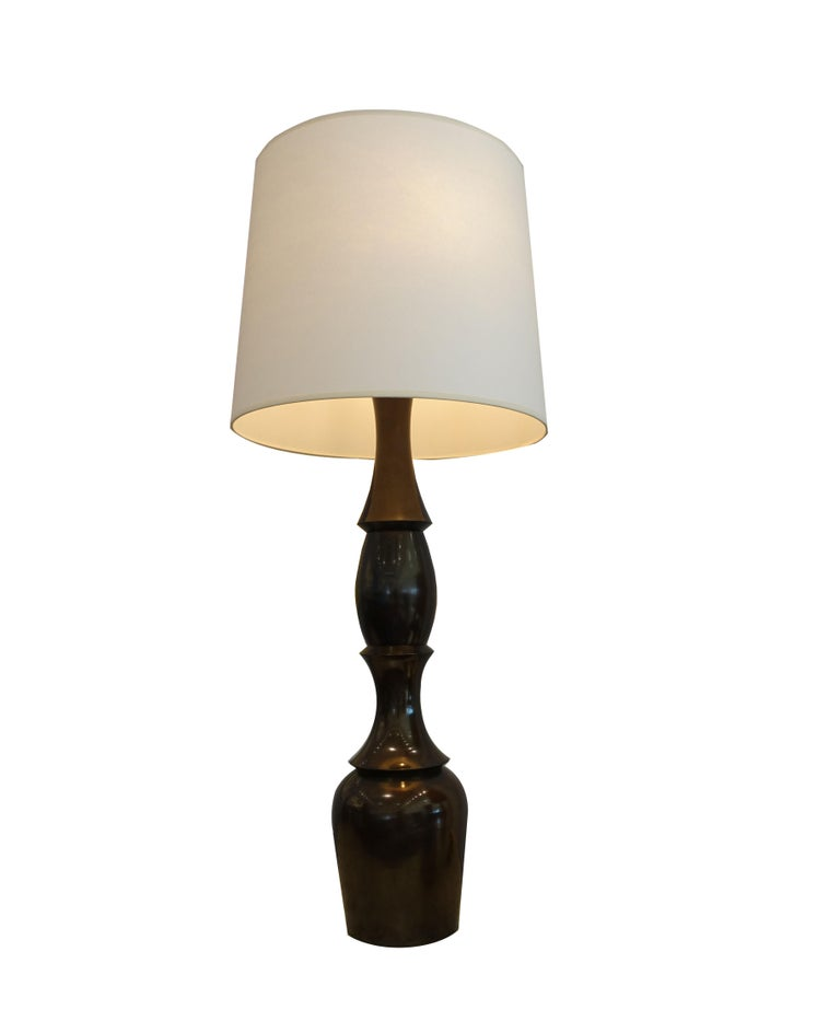 Oversized, unusual shape urn-style antique bronze table lamp. Newly rewired with dual pull chain light sockets and brass stem / finial. Brown twisted silk cord. Excellent vintage condition.