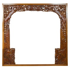 Oversized Antique Chinese Carved Wooden Frame with Birds, Foliage and Tree Limbs