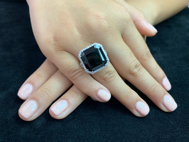 Here is a nice natural tourmaline and diamond ring. The natural tourmaline is certified by City Gem Testing Laboratory. It is not treated or enhanced in any way. The ring is set in 18k white gold. The center tourmaline is cut corner square faceted.