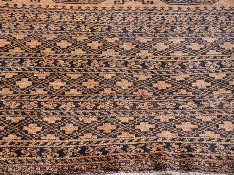 Large oversized tribal rug Afghan Ersari Turkoman or Turkmen rug  The Turkmen or Turkoman people are settling in villages in Afghanistan an Turkmenistan near the Persian border. Their origin is tribal nomadic, but most members of the tribes have
