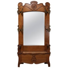 Oversized Horner School Carved Oak Lift Seat and Mirrored Hall Tree, circa 1910