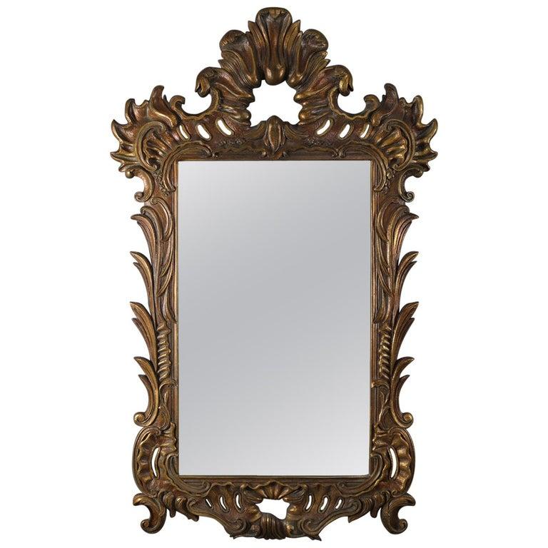Oversized Italian Rococo Giltwood Foliate Form Overmantel Mirror, 20th Century For Sale