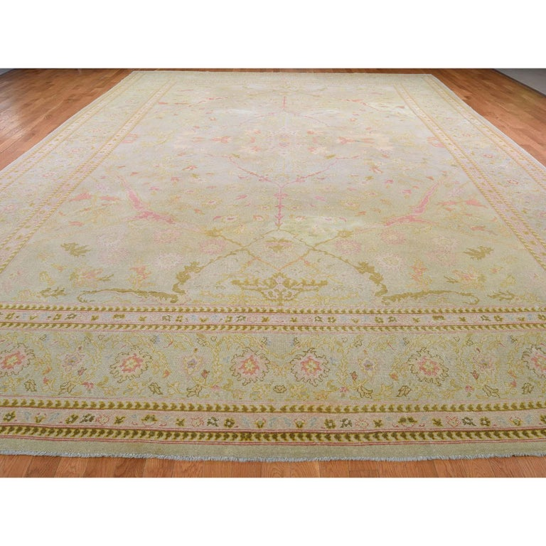 This is a truly genuine one-of-a-kind oversized light green vintage Turkish Oushak hand knotted rug. It has been knotted for months and months in the centuries-old Persian weaving craftsmanship techniques by expert artisans.  Primary materials: