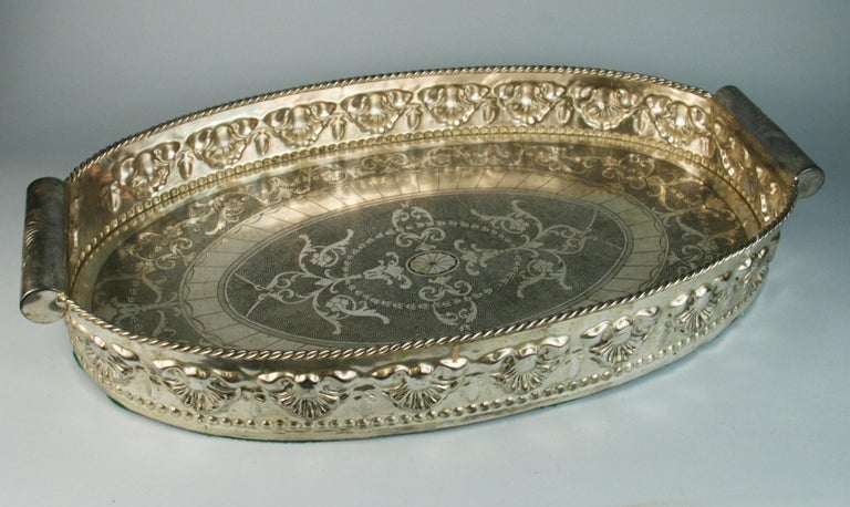 3-620 English  silvered brass  high bordered gallery barware or serving tray with intricate detailing with round handles.