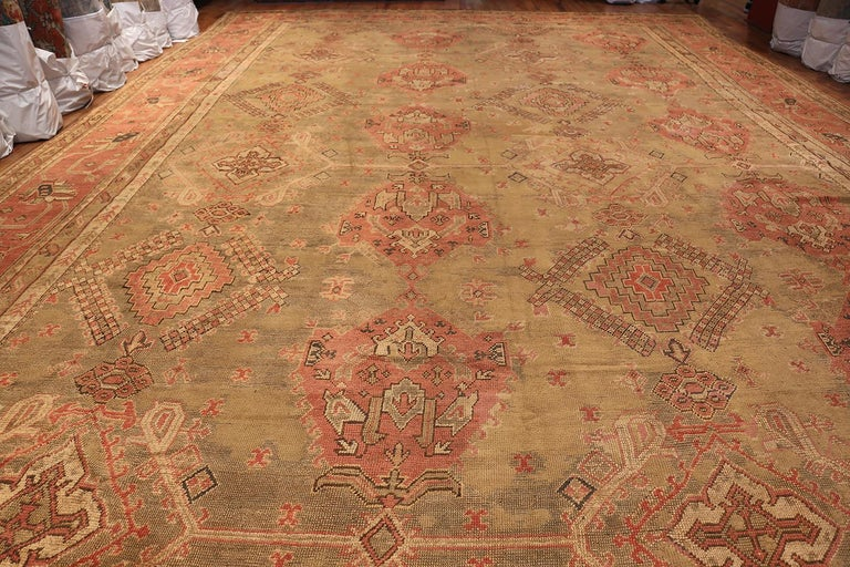 Tribal Oversized Antique Turkish Oushak Rug, Country of Origin: Turkey, Circa Date: 1900 — Size: 16 ft 3 in x 24 ft 7 in (4.95 m x 7.49 m).