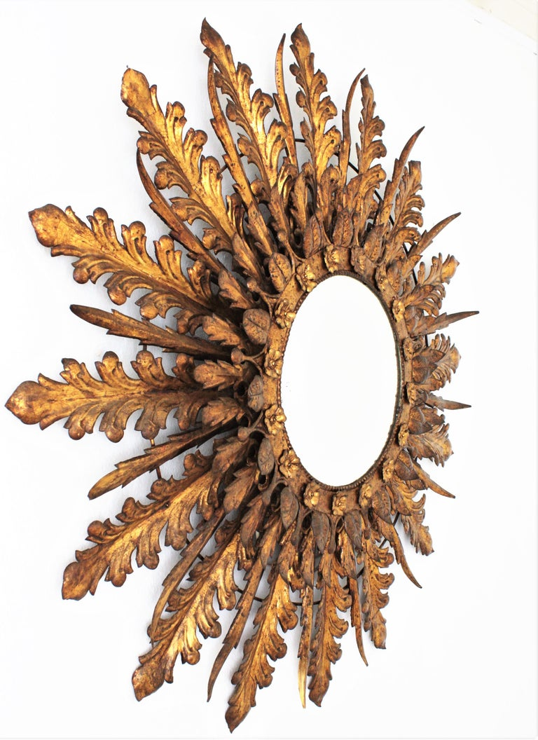 Hammered Oversized Triple Layered Gilt Metal Baroque Style Sunburst Mirror, France, 1930s For Sale